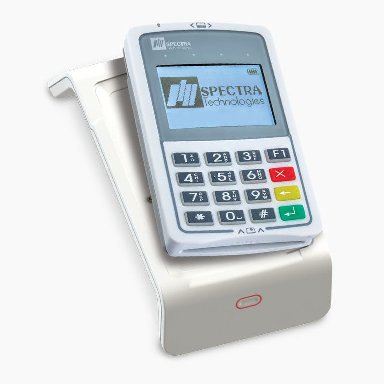 Close up shot on a customer's hand while holding mobile smart phone over credit card reader for contactless payment transaction.